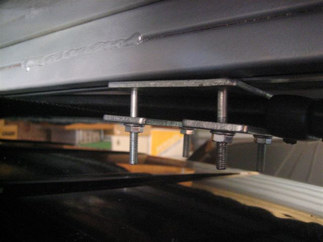 This is side-to-side mounting  on a JEEP Cherokee for the  'Roof Topper 8' - Roof Top Tent.  Click this image for a larger  zoomed view.